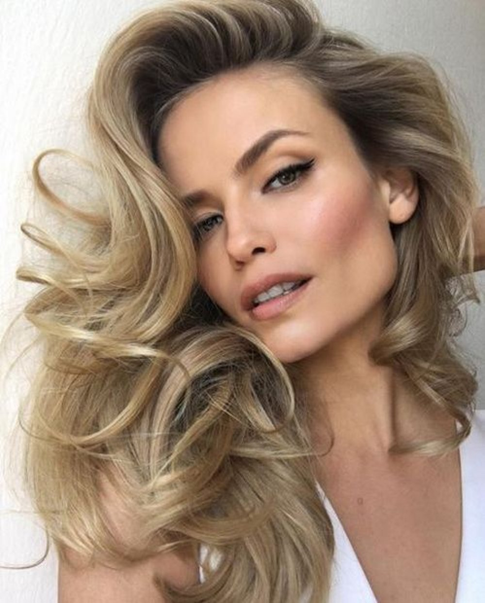 Secretele unui păr buclat strălucitor și sănătos